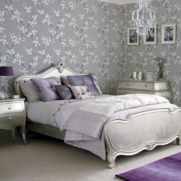 a romantic pastel glam bedroom with grey printed walls, refined furniture, touches of lilac and purple