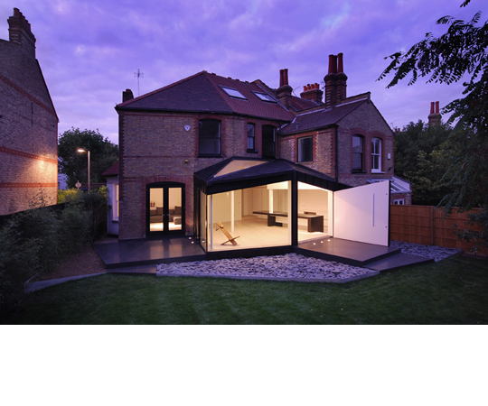 Modern Black Extension of the Victorian House