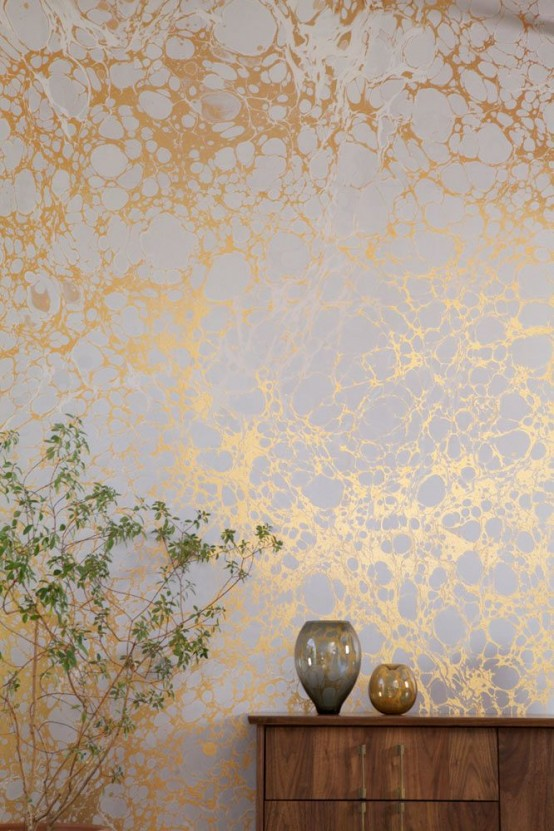 gold and white marble wallpaper is a beautiful accent to the space and a glam touch, it will work for many styles