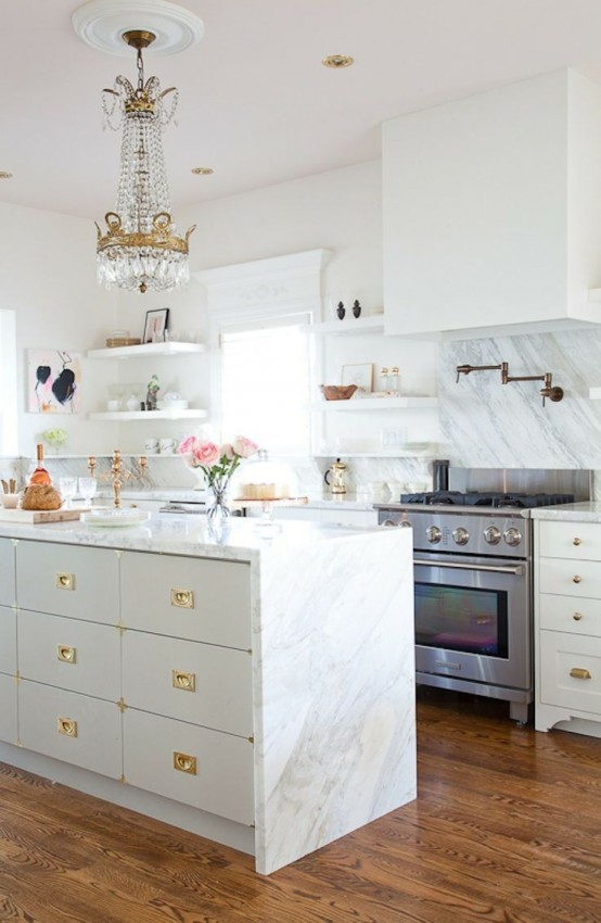 a neutral glam kitchen spruced up with gold knobs, gold fixtures, a gold candelabra, a crystal chandelier with a gold touch is refined and beautiful