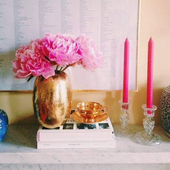 a beautiful gold vase and a teacup with asaucer easily glam up the space and make it look stylish and cool