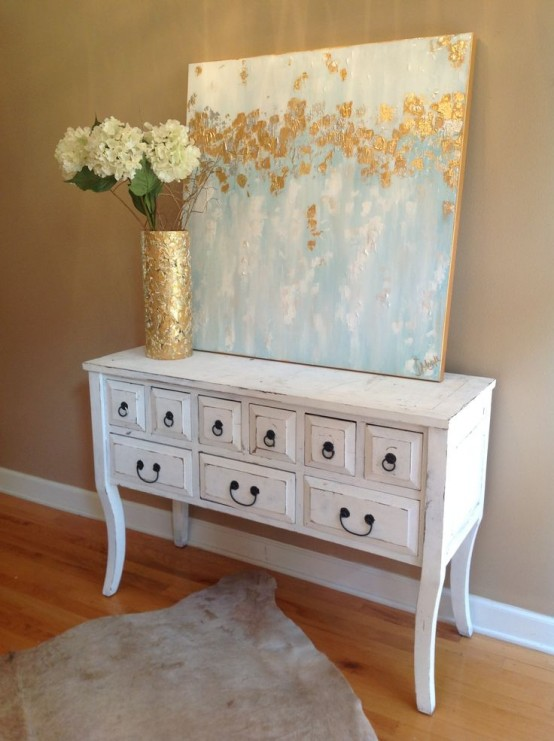 a gold foil vase and an abstract artwork with light blues and gold foil touches is a lovely idea
