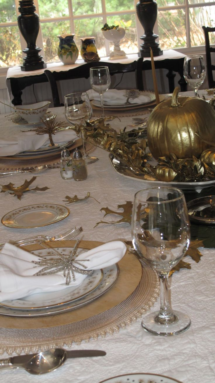 gilded leaves and pumpkins, gold chargers and plates for a chic and refined vintage inspired Thanksgiving tablescape