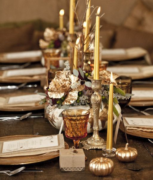 gold candleholders, gold pumpkins, leaves and chargers are amazing for Thanksgiving