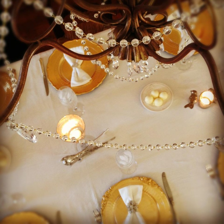 gold chargers and candleholders, crystals will add a refined and chic feel to your Thanksgiving table