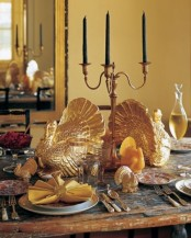 gold turkey figurines, gold candleholders, gold cutlery will make your Thanksgiving tablescape refined, chic and vintage