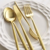 white porcelain paired with gold cutlery will help you create a refined and chic Thanksgiving tablescape
