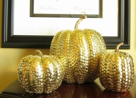 gold thumbtack decorated pumpkins will be nice and shiny decorations for Thanksgiving