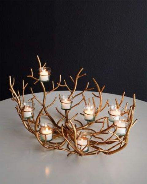 a gold botanical candlelabra with multiple candles is a chic idea for Thanksgiving decor