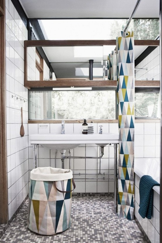 a neutral farmhouse bathroom with a geo printed shower curtain, a matching fabric basket is a chic and stylish space