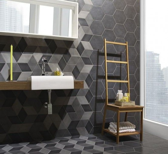 a contemporary dark-colored bathroom with geometric tiles, hexagons with color blocking and without looks amazing