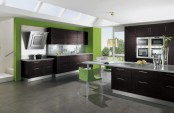a bright black and neon green ktichen with white countertops and stainless steel appliances is a bold and cool space