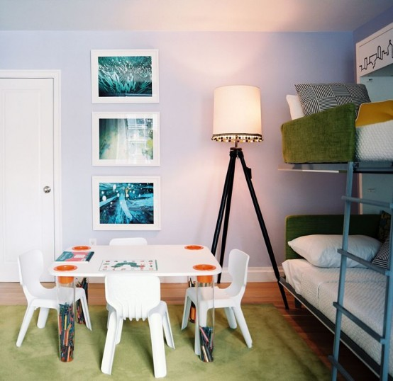 Green kids bedroom that is designed for having little guests.