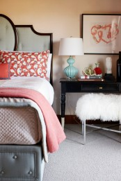 a bright bedroom done in ocher, coral and grey, with dark stained wooden touches plus dark furniture