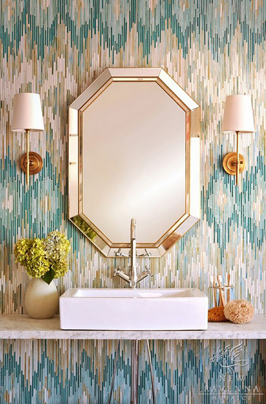 a bright guest toilet with a geometric mirror, bright printed wallpaper, a square sink