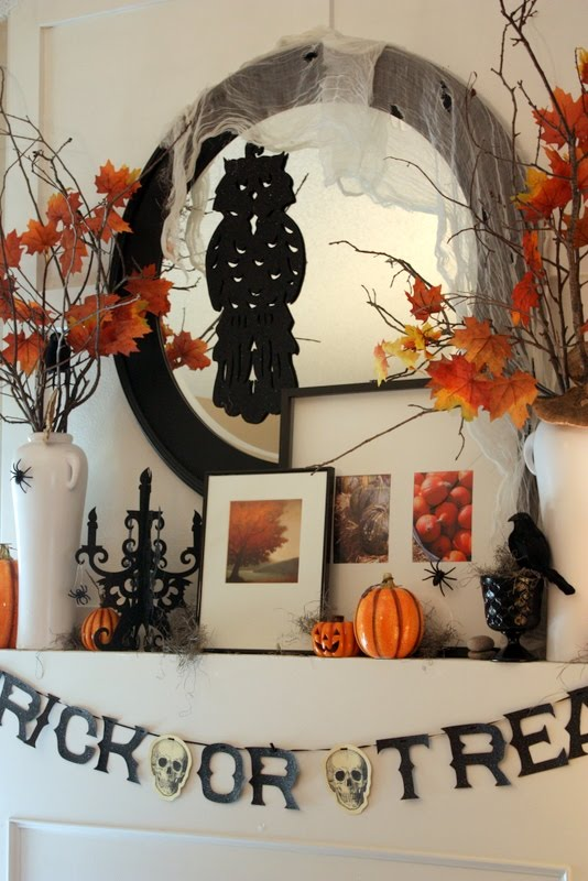 To add a contemporary touch to your Halloween mantelscape put a bunch of modern picture frames with gorgeous photos of autumn there.
