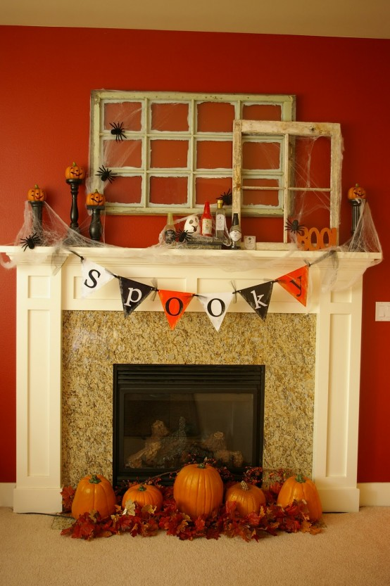 Two antique window frames gets a holiday makeover thanks to a creepy spider webs and spider silhouette cutouts.