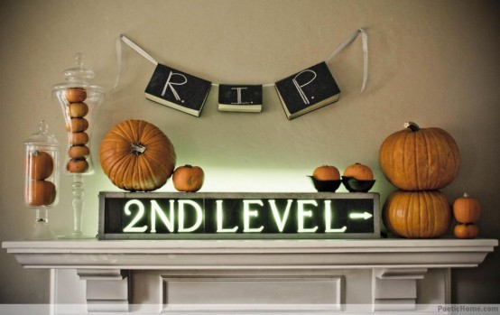 Write a ghoulish message on chalkboard pieces and hang it right above your mantel.