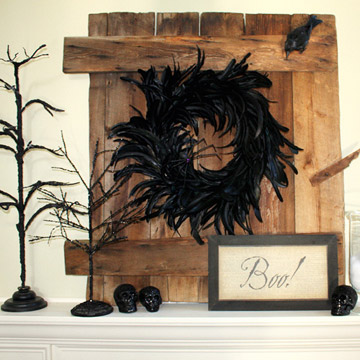 A bunch of rustic wood boards with a black wreath on them could become a great addition to your living room's Halloween decor.
