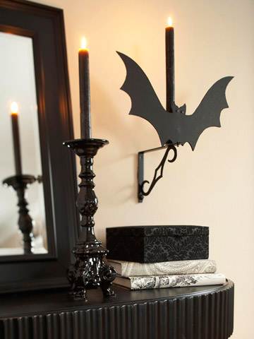 Attach black cardboard bat silhouettes to your wall lights.