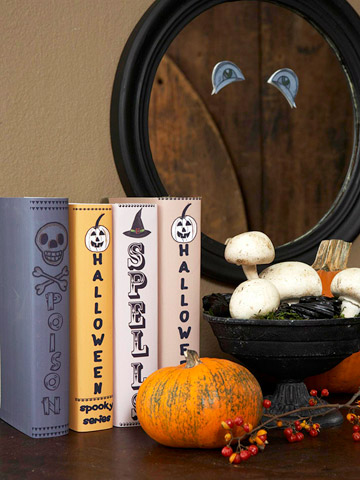 Wrap some of your books with heavy-duty brochure paper. Attach your own text and Halloween embellishments on them.