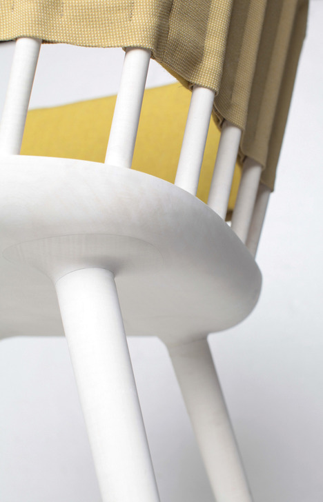 Hammock Table And Dowel Chair Decorated With Bright Fabric