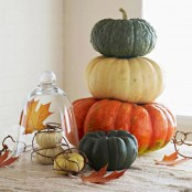 simple heirloom pumpkins stacked and palced in a cloche look very cozy and very fall-like, such easy natural decor