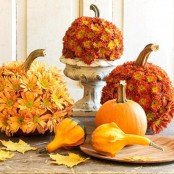 gourds and pumpkins covered with bold fall blooms are lovely for fall or Thanksgiving decor
