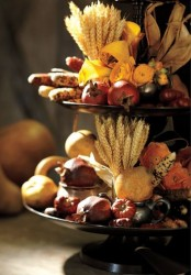 a metal stand with various faux veggies, wheat, corn husks and blooms is a beautiful and cool rustic decoration for Thanksgiving