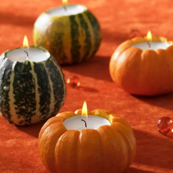 gourds and pumpkins carved to hold candles are cool for natural and cozy Thanksgiving decor or just for fall
