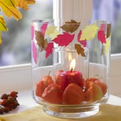 a glass with dried blooms and colorful leaves plus one more glass with a candle is a lovely decoration to rock