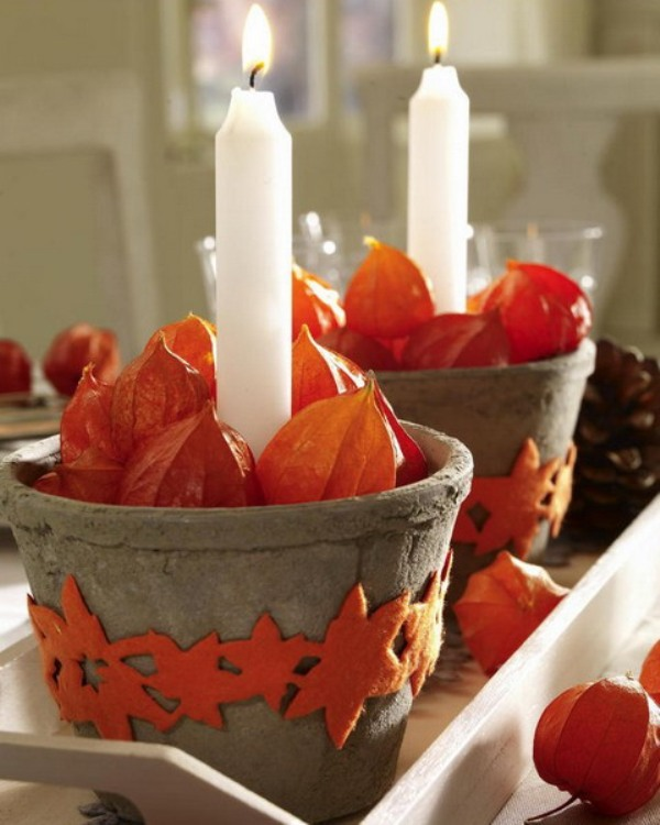 concrete buckets with dried blooms and candles and star covers are pretty and stylish and will match fall or Thanksgiving decor