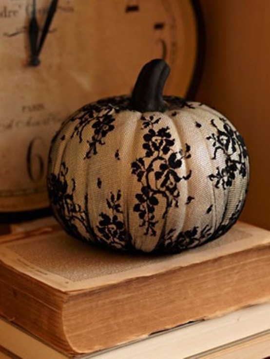 a white pumpkin covered with black lace is a pretty decoration for fall or Thanksgiving