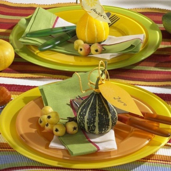 a bright Thanksgiving tablescape with berries and mini gourds, bright striped table runners and mini veggies