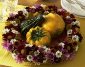 a bold purple faux bloom wreath and gourds and pumpkins is a cool fall or Thanksgiving decoration to rock