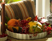 a tray with faux veggies and berries is a lovely Thanksgiving centerpiece of