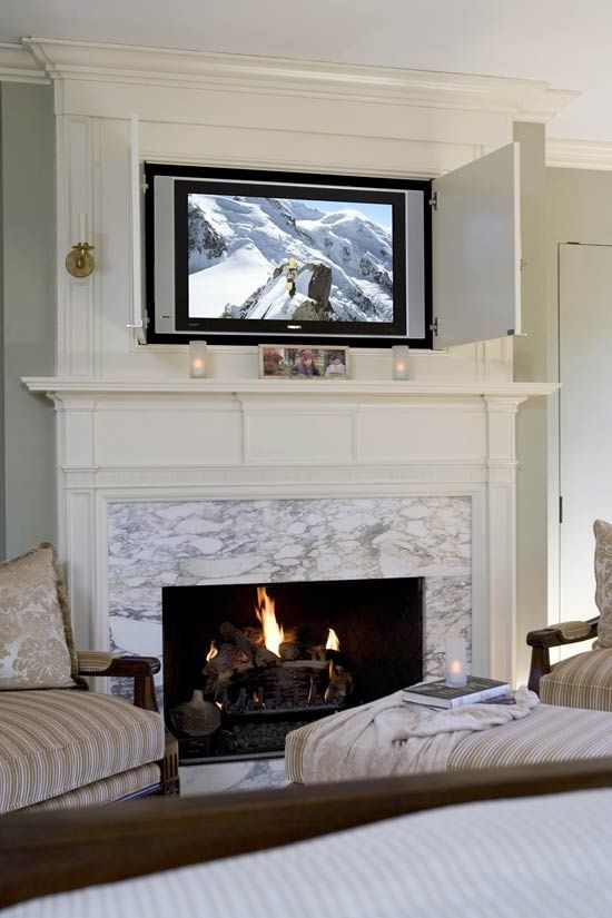 Hiding your tv 29 trendy panels and doors ideas digsdigs Hide fireplace ideas