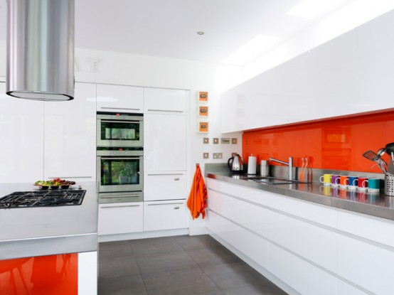 High Gloss Kitchen With Orange Backsplash