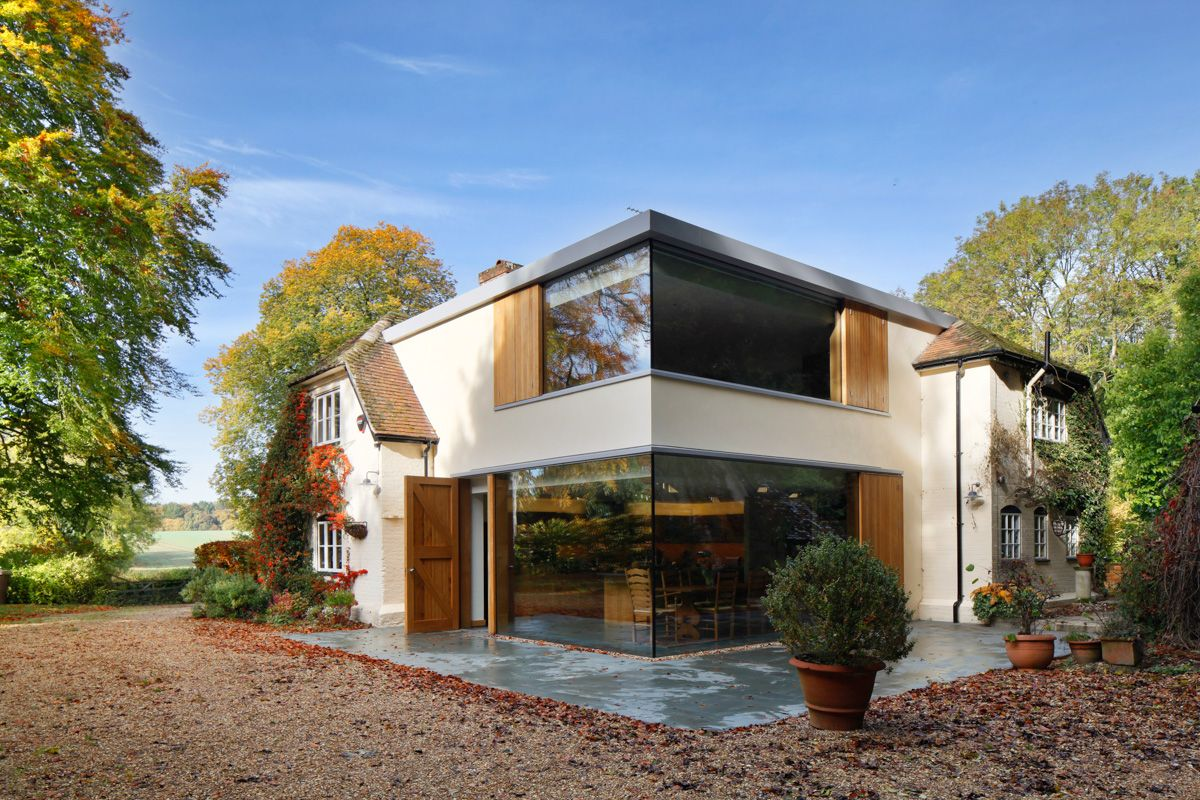 Historical english cottage with a glazed cantilevered for Cottage extension designs