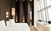 Hotel Bedroom With Huge Doors And Windows