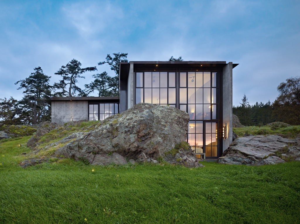 Pierre House With A Contrasting Interior Nestled Into The Rocks