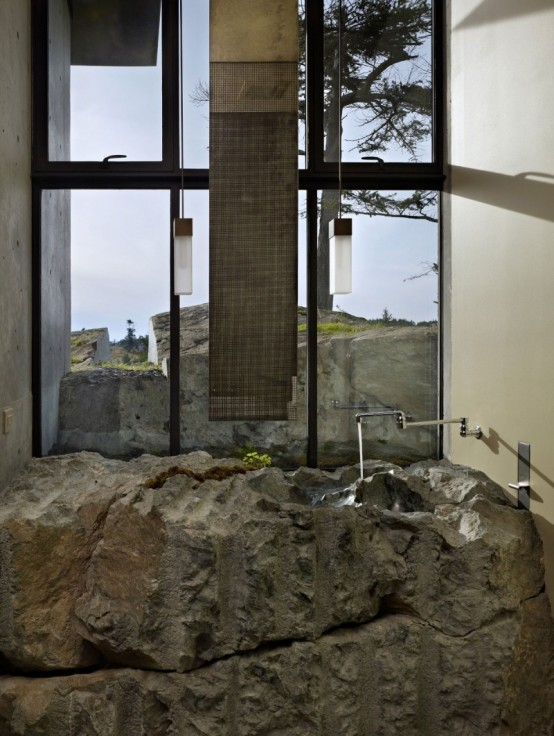 House With A Contrasting Interior Nestled Into The Rocks