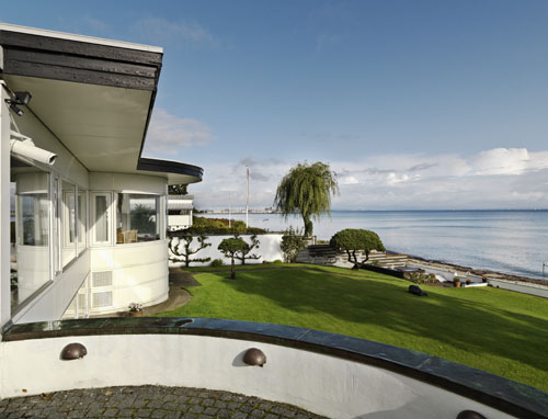 House Shaped as a Furniture Set With a Stunning View of The Sea
