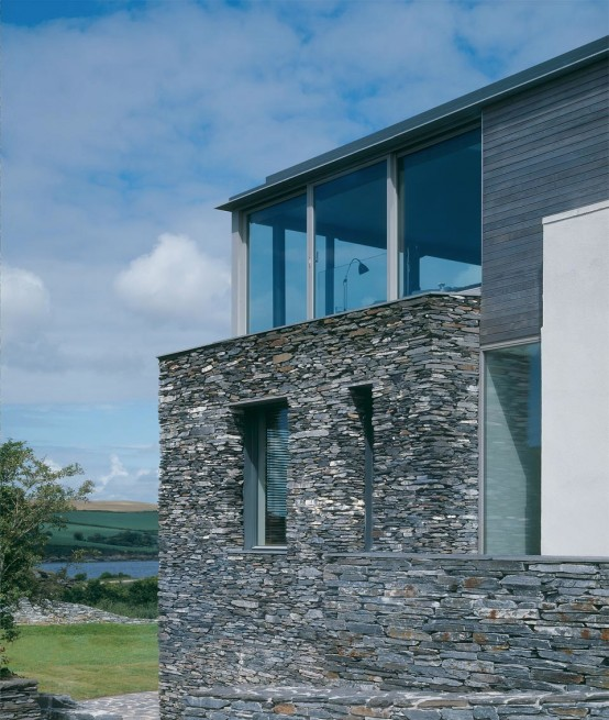 Sustainable House With Raw Stone Exterior - DigsDigs