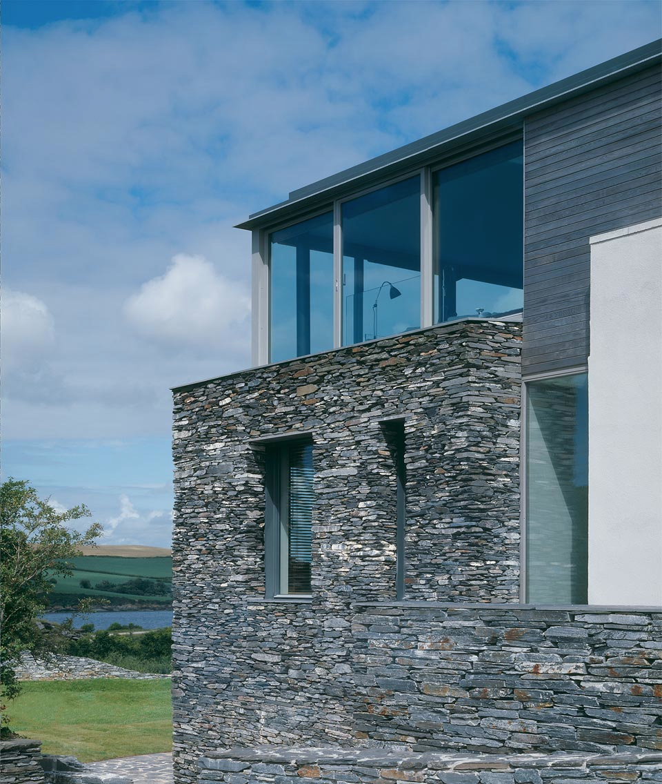 Exterior: Sustainable House With Raw Stone Exterior