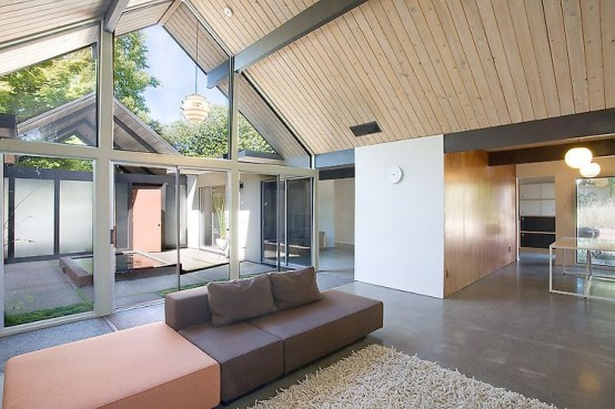 House Wraped Around The Open Atrium With High Double Gables
