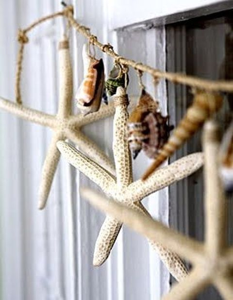 a catchy twine and seashell and starfish garland can be hung anywhere - on the window, on a shelf or wherever else you want