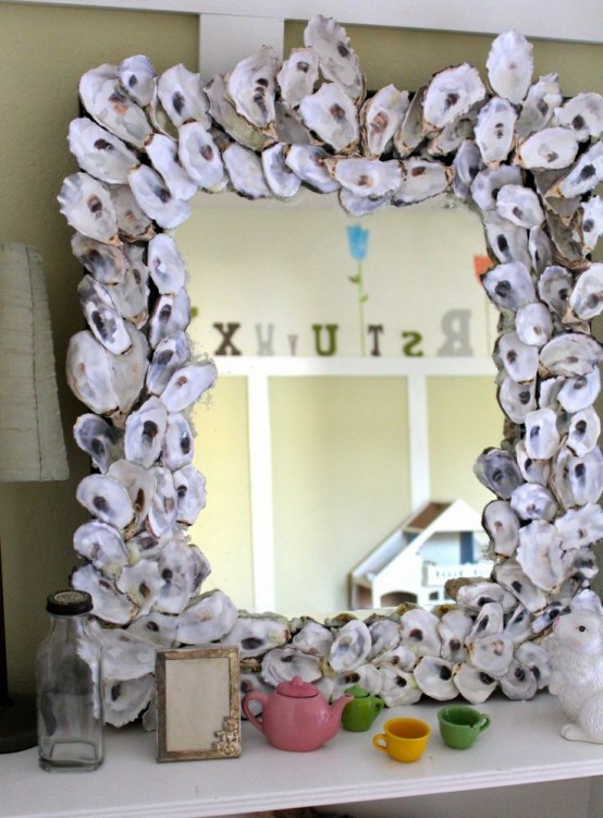 cover a mirror frame with large seashells to make it feel beachy and decorate any space you want with it