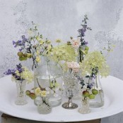 vintage sheer glasses and vases with various wildflowers will give a slight summer feel to the space and can fit both a vintage and a boho space