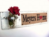 a shabby chic sign with a burlap touch, a jar with a red rose is a nice decoration for any space with a vintage or rustic feel